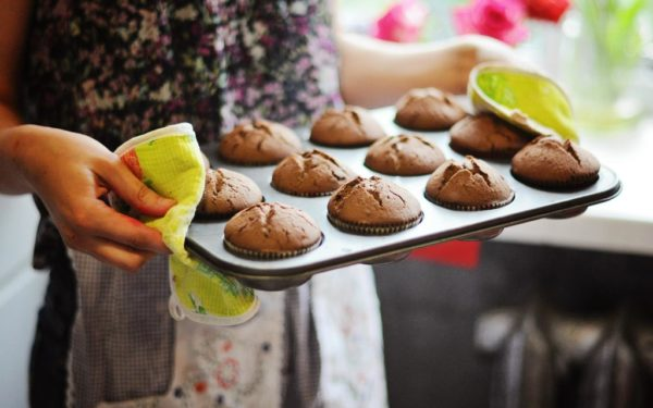 holding tray of muffins fresh baked - frugal gifts