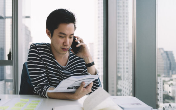 man on phone with credit company - best credit monitoring service