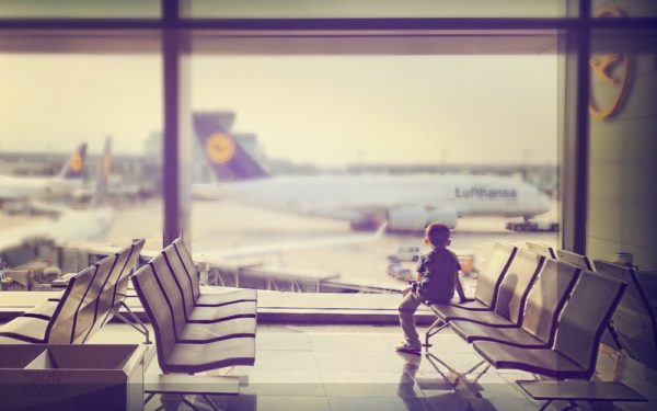 kid at airport - why i finally bought travel insurance