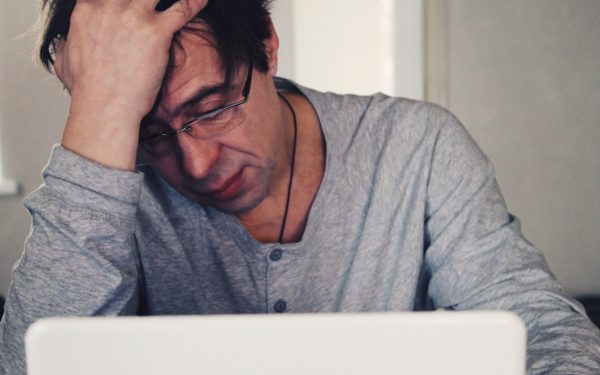 stressed man worrying about medical debt
