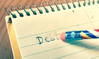 erasing debt in notebook page - bankruptcy debt and credit scores