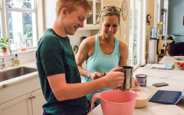mom teaching son how to cook
