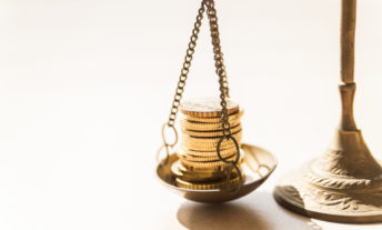 gold coins on a scale - rebalancing your investments