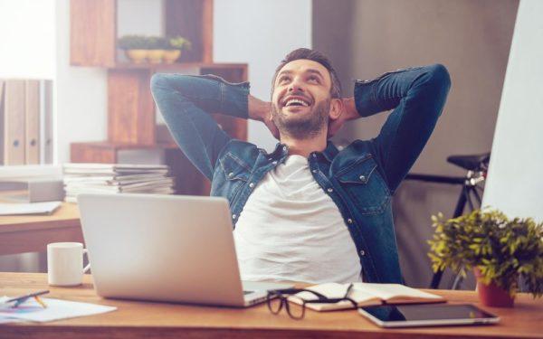 happy man celebrating at computer