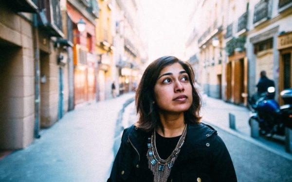woman walking down a street in madrid