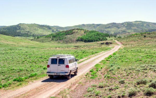 vanlife van on dirt road country mountains travel