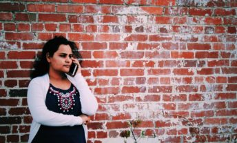 concerned woman talking on phone