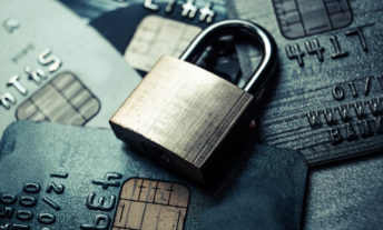 padlock over credit cards - credit monitoring and identity theft