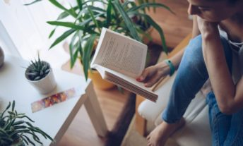 woman reading a book - tips for a digital detox unplugged weekend