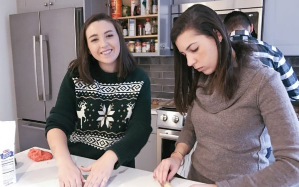 friends cooking together in kitchen - gifts that matter