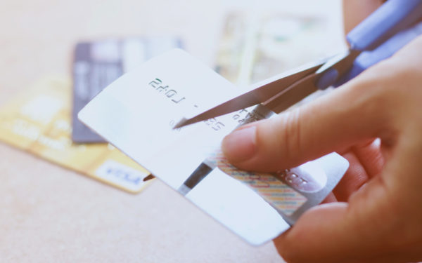 cutting credit card with scissors - dave ramsey credit cards