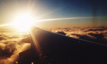 view of sunrise from airplane window - citi prestige card review