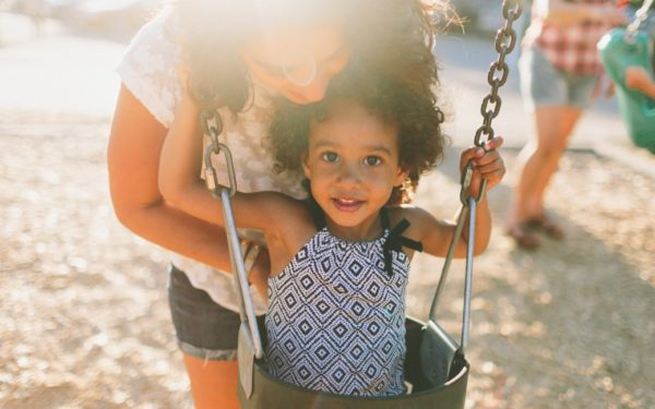 mom and daughter at playground - save money parenting any age child