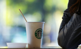 starbucks coffee cup at cafe