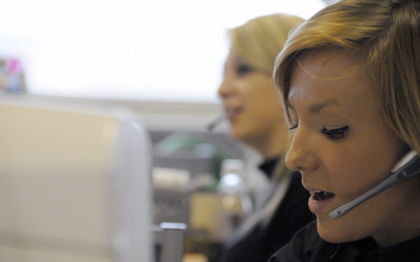 woman speaking on headset travel agent