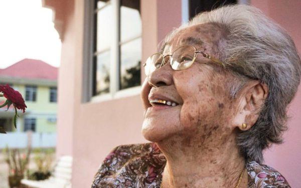 happy senior woman laughing