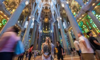 woman at sagrada familia cathedral in barcelona spain - book tours and excursions with credit card rewards