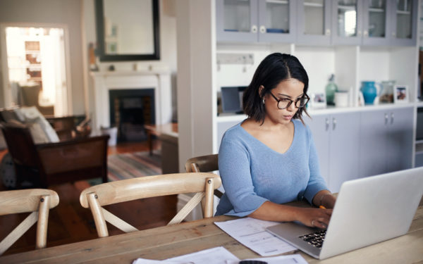 young woman using a laptop while working from home