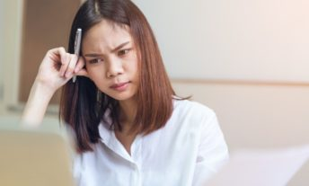 woman stressed at work - make money online surveys harder than it sounds