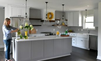 woman in newly remodeled kitchen