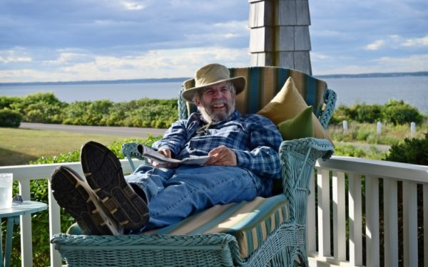 happy retired man reading in hammock on martha's vineyard - annuity myths about annuities