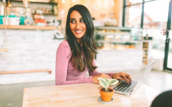 smiling young woman working at coffeeshop