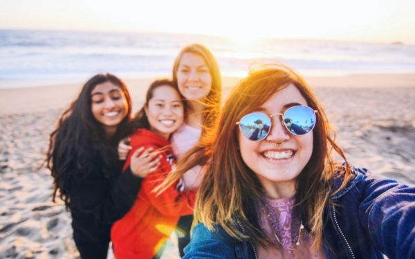 friends taking selfie at the beach