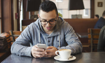 man using beam app at coffeeshop - beam review