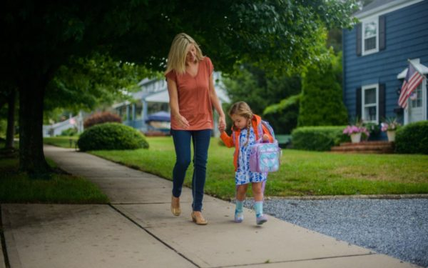 mom and daughter walking to school - 529 vs brokerage account for college savings