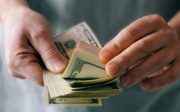 counting cash in hand - borrow against cash value life insurance
