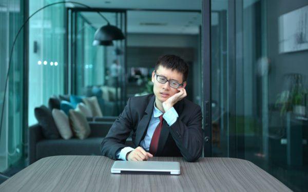 depressed businessman in office