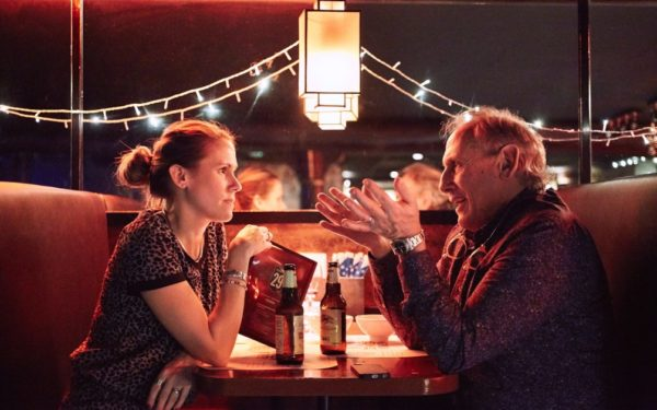 father talking to adult daughter over beers - conversations to have before retirement