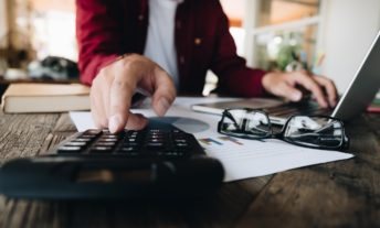 using a calculator - how financial planners invest their own money