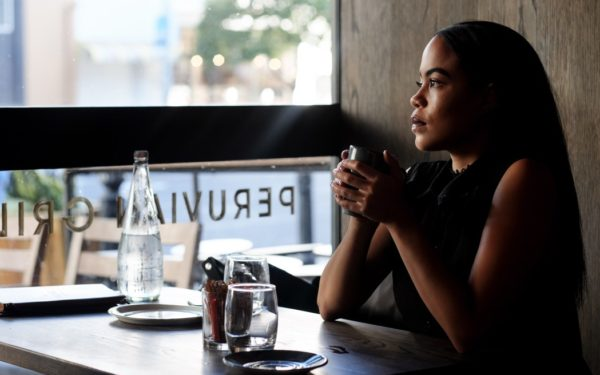 woman at coffeeshop lost in thought