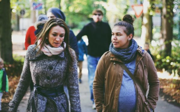 two women talking in a park