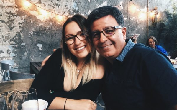 father hugging adult daughter