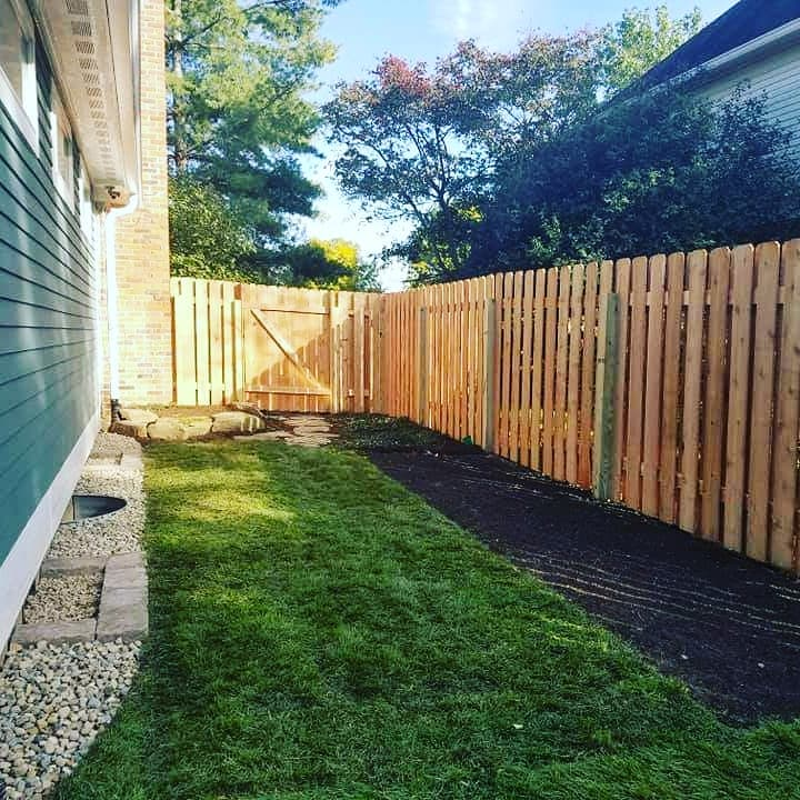 new fence and yard after remodeling project