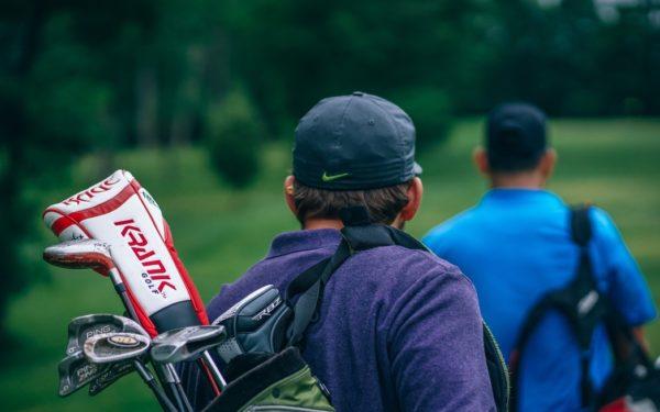 golfers walking on golf course