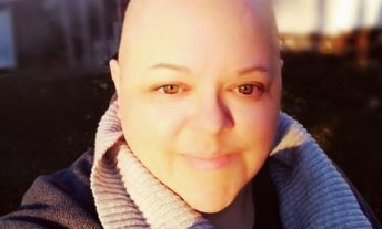 woman receiving chemotherapy treatment - deferred student loans for cancer patients