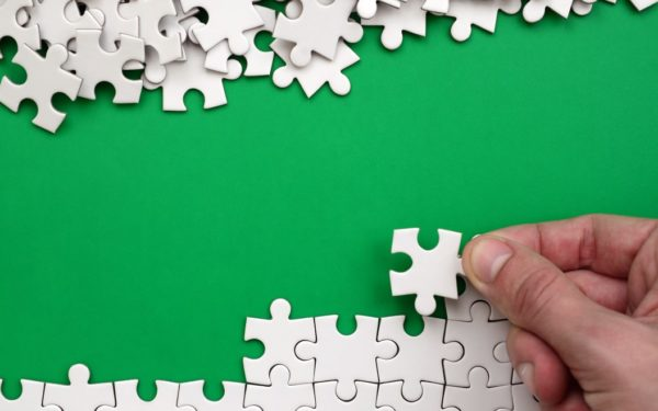 solving a jigsaw puzzle one piece at a time