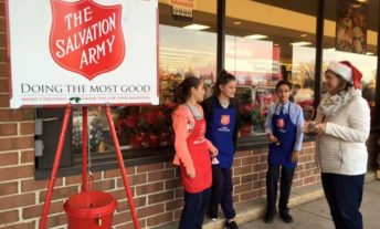 salvation army bell ringer outside supermarket - charitable giving deduction changes 2018