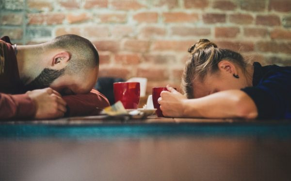 couple stressed out with coffee