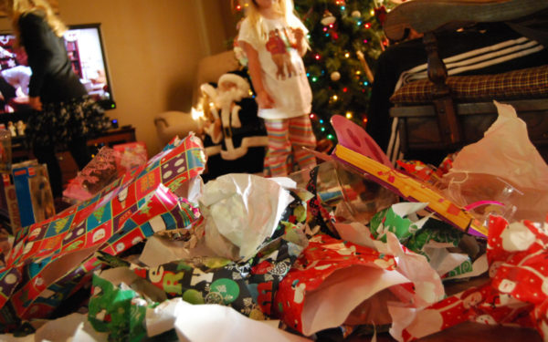 mess of wrapping paper in aftermath of christmas - how to pay off holiday debt