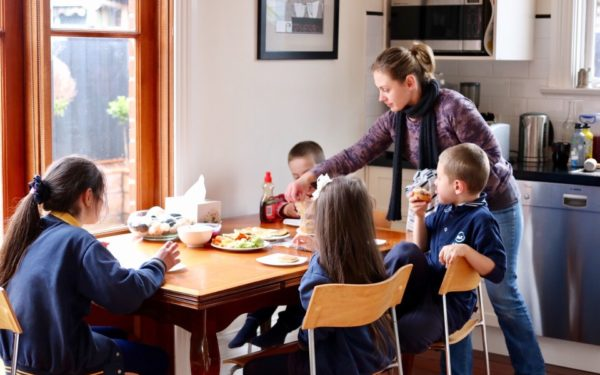 family with kids eating at kitchen table