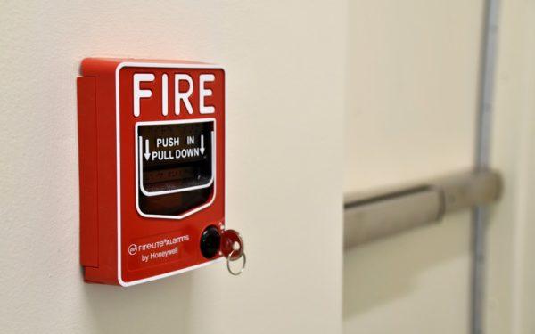 fire alarm next to a doorway - financial fire drill