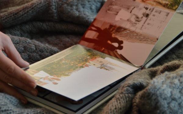 woman looking through old photo album
