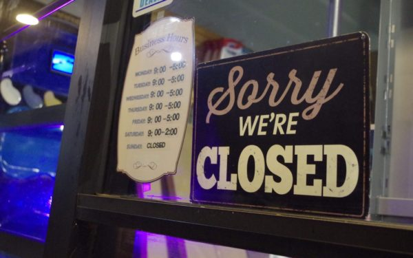 closed sign in window - government shutdown and your credit