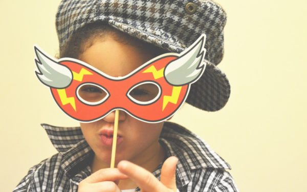 child wearing mask - warning signs of child identity theft