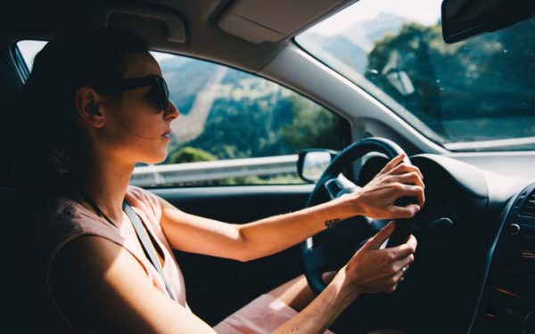 woman driving - ways to save money on car insurance rates