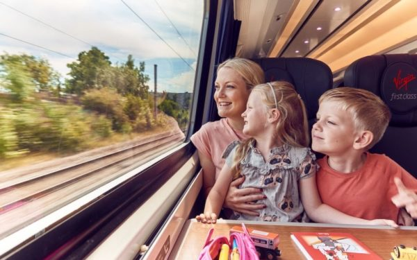 happy laughing family traveling on train